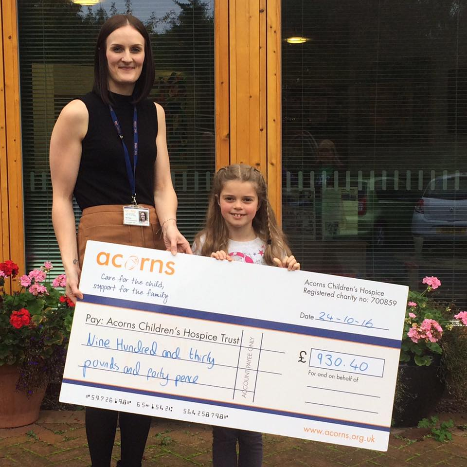 Sophie presents cheque to Acorns